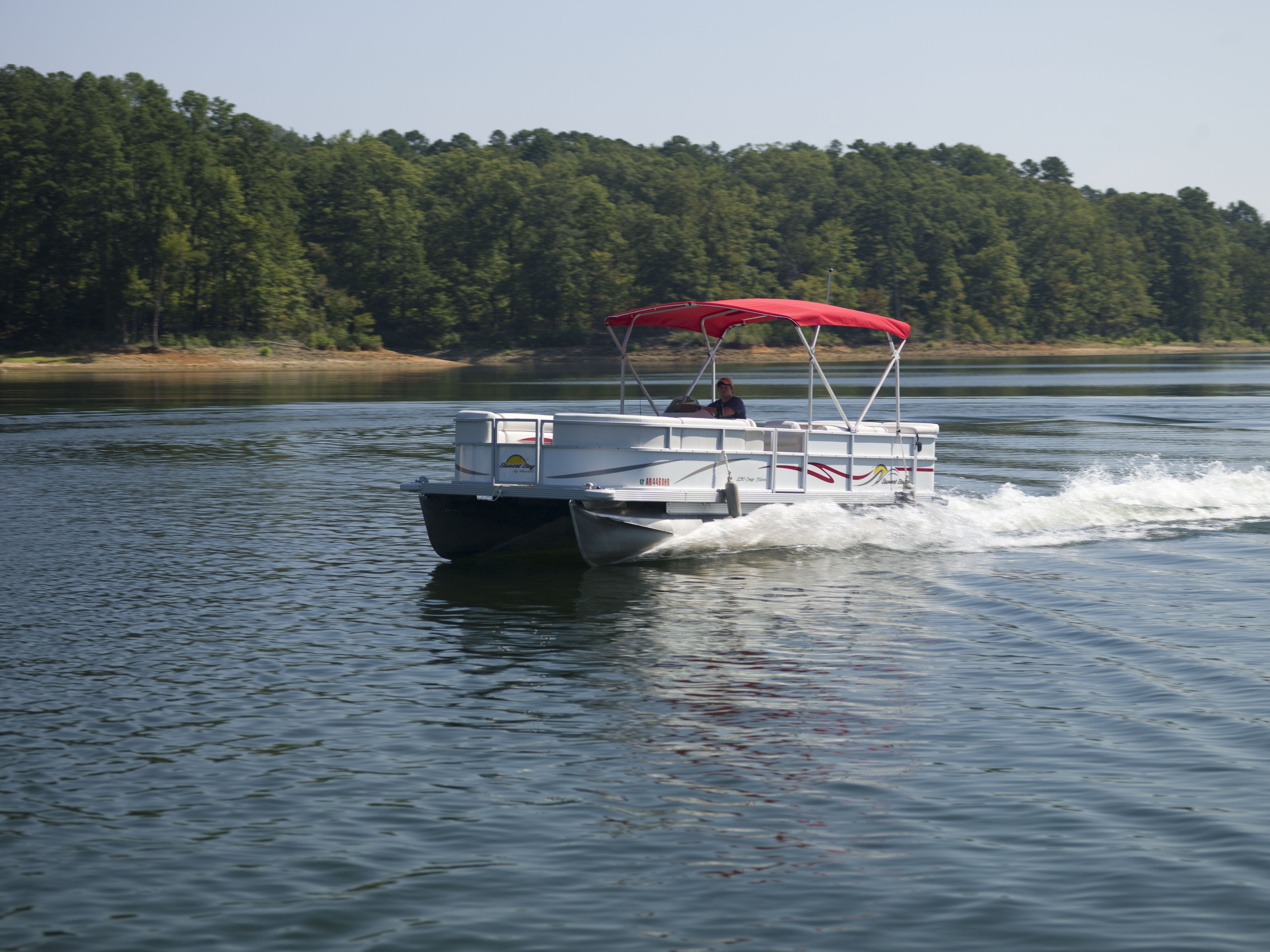 view of boat cruising Lake Ouachita